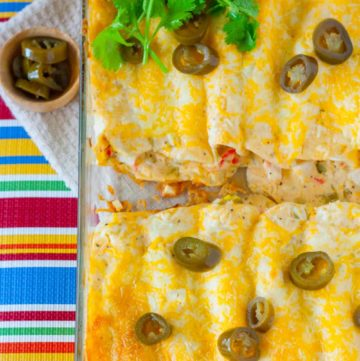 Creamy White Sauce and Crab Enchiladas in a baking dish