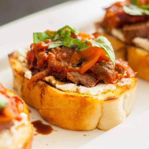 Steak Bruschetta with Goat Cheese and Tomato Jam
