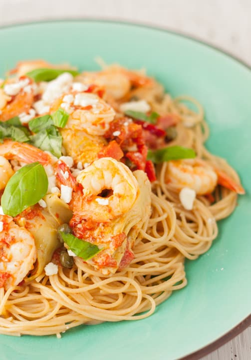 Creamy Shrimp Pasta with Artichokes and Roasted Red Peppers served on a plate