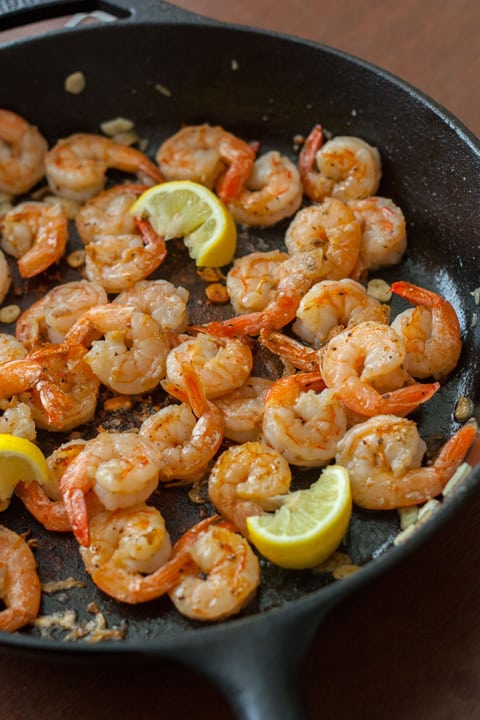 Process shot of shrimp cooking in a pan