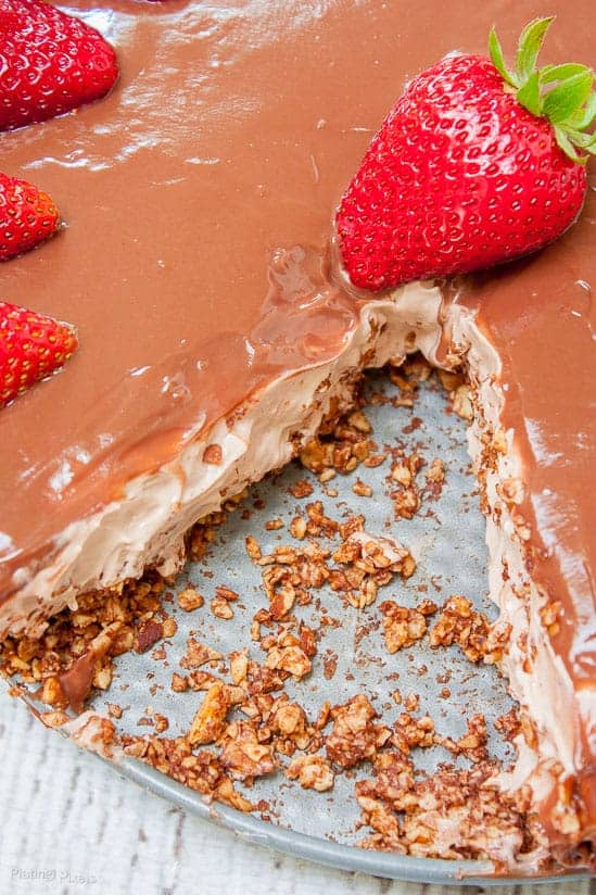 Close up of no bake Chocolate Pudding Cheesecake garnished with strawberries