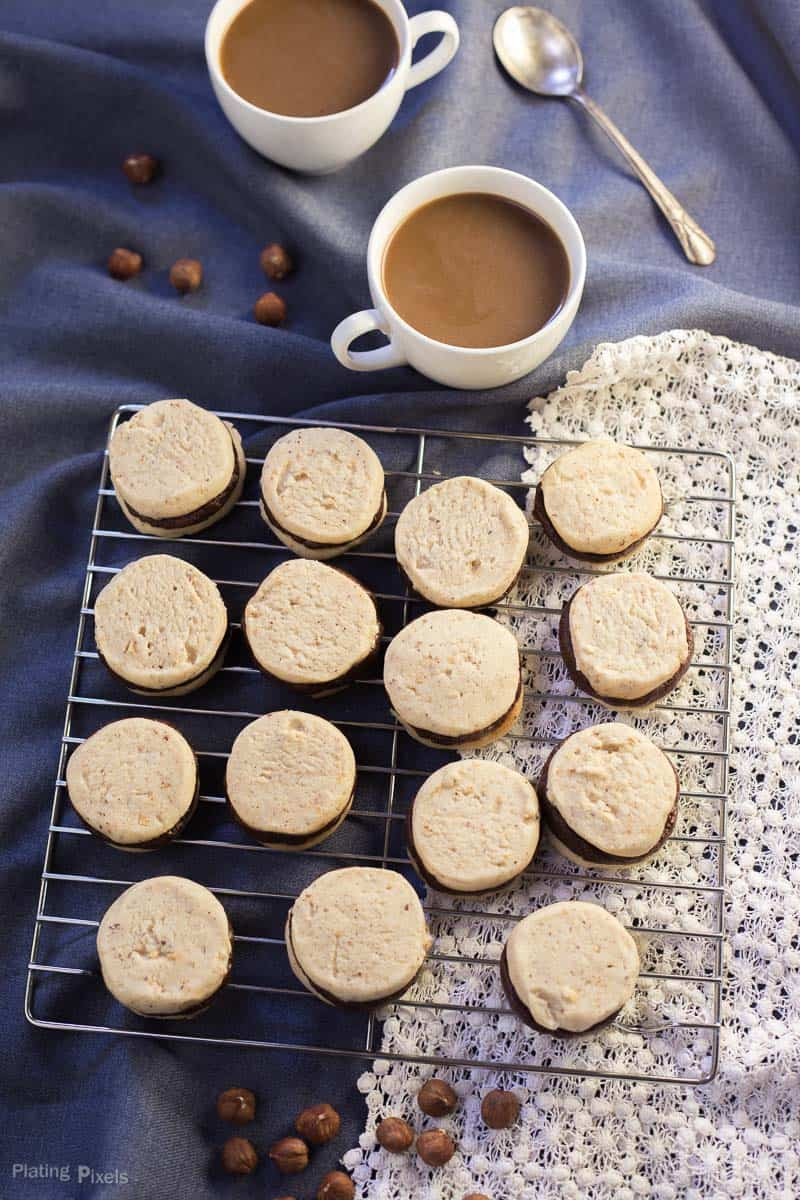 Assembled Pumpkin Spice Chocolate Hazelnut Shortbread Sandwiches on a wire cooling rack
