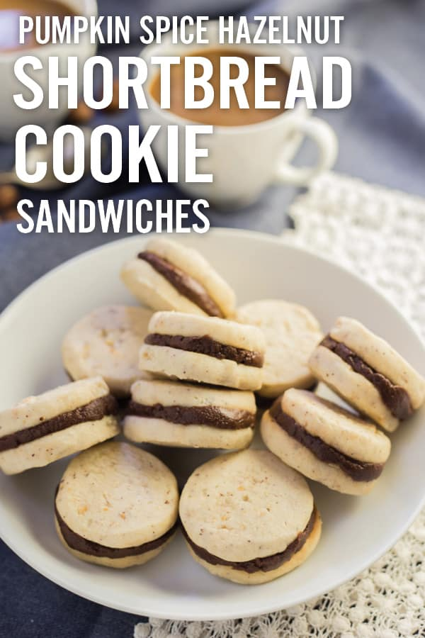 Learn how to make food processor dough with Pumpkin Spice Chocolate Shortbread Cookies Sandwiches. Fresh hazelnuts and pumpkin spice added to make them even more festive. Oh yeah, and it\'s also got flavored creamer baked right in! #shortbread #cookiesandwich #fallcookie #pumpkinspice