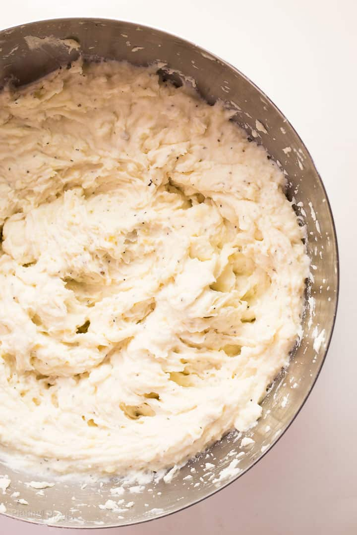 Easy Creamy Mashed Potatoes in a large metal bowl