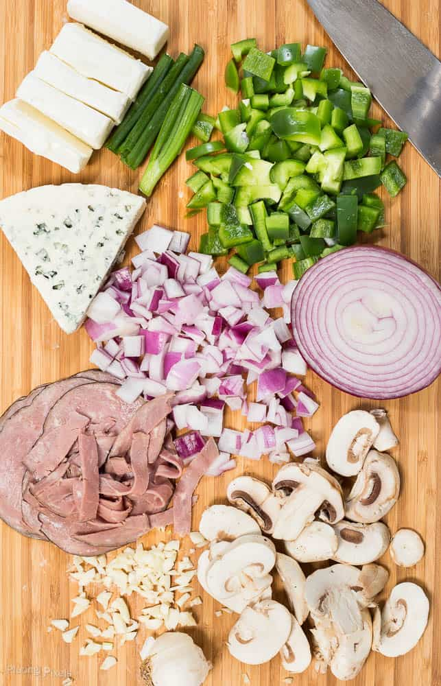 Ingredients on a board for making a Philly Cheese Steak Dip