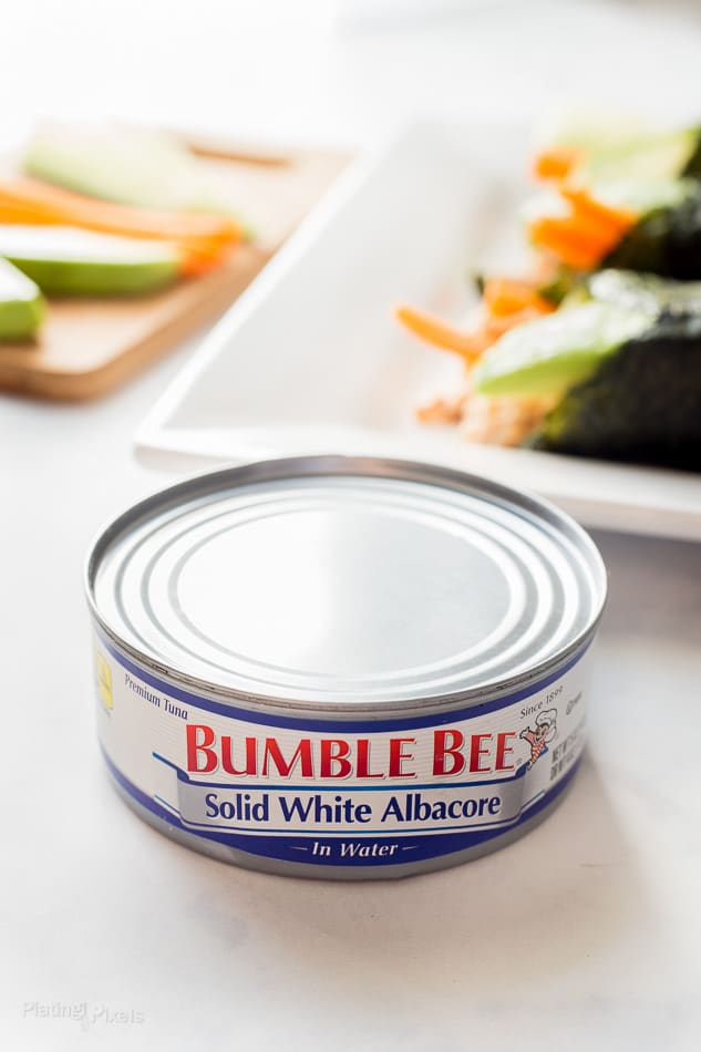 A tin of Bumble Beee white albacore tuna sitting on a white table