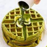 Matcha Green Tea Waffle on a white plate with matcha syrup