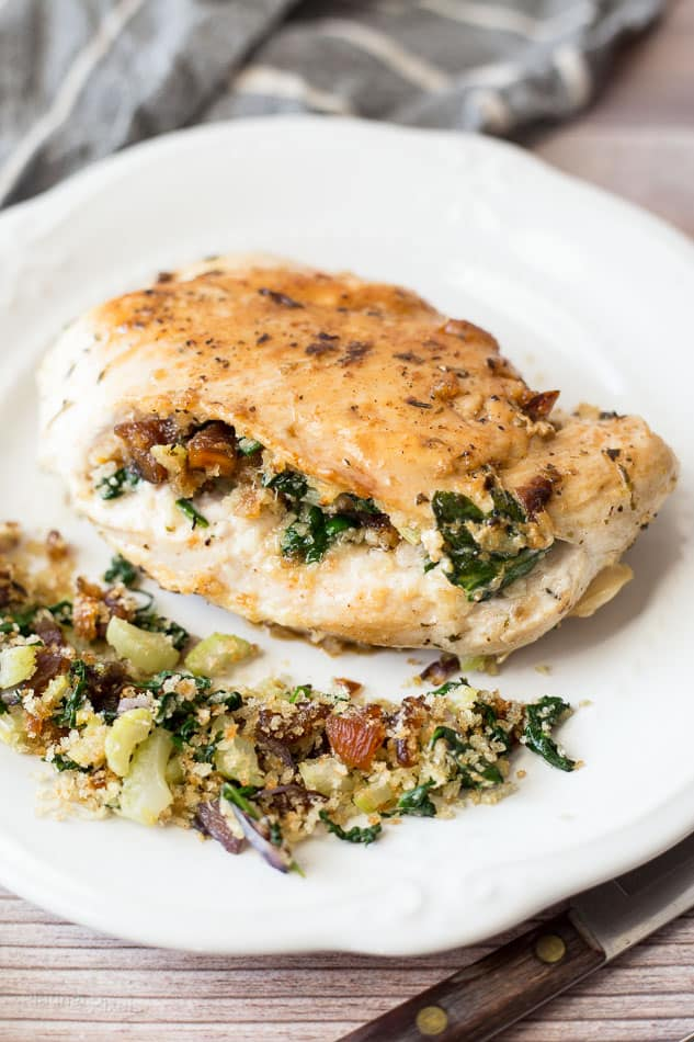 Apricot and Spinach Stuffed Chicken Breasts on a white plate