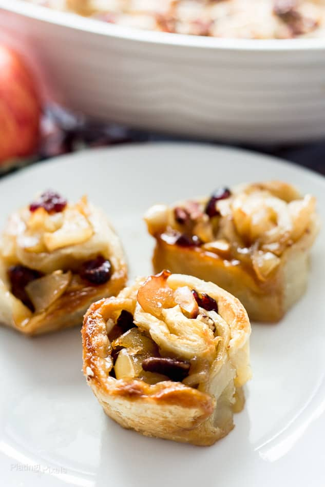 Three Apple Pie Puff Pastry Rolls on a plate