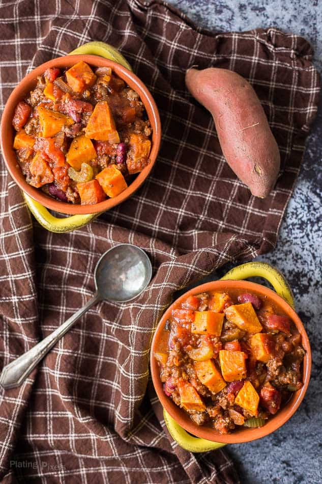 An overhead shot of two bowls of roasted sweet potato chili