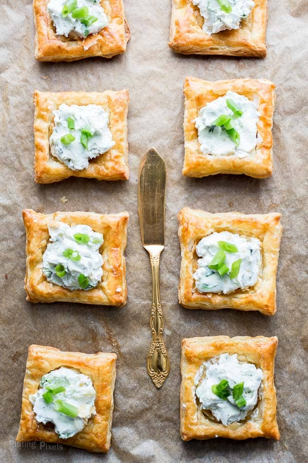 An overhead shot of Blue Cheese Puff Pastry Squares on a baking shot