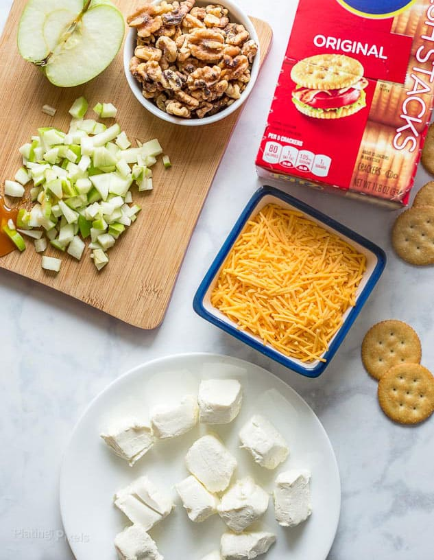 Ingredients to make a cheese ball recipe prepared on a counter