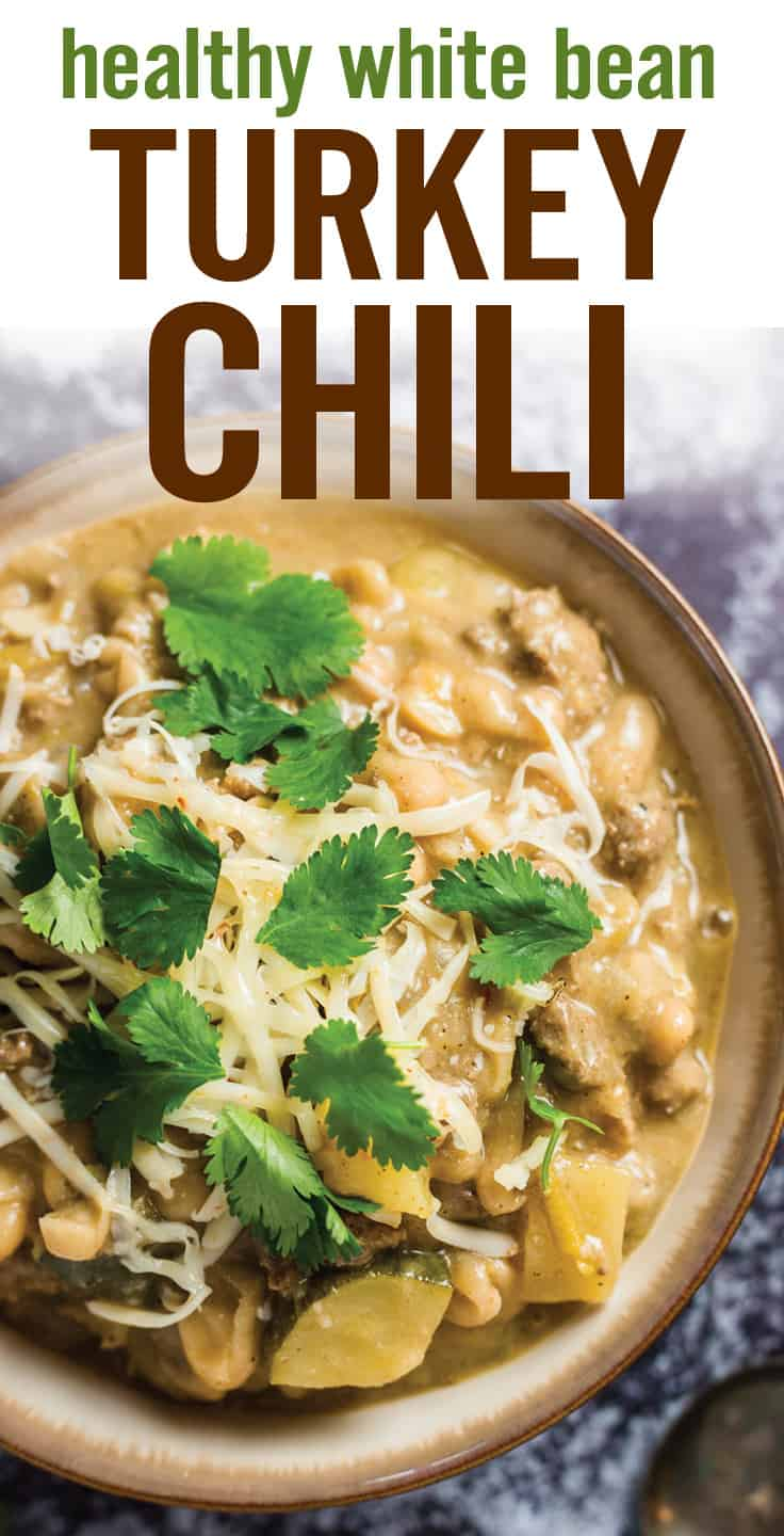 Quick and easy Healthy White Bean Turkey Chili. Lightened up with lean protein, cannellini beans, zucchini, pepper jack cheese and spices for a gluten-free, cozy and comforting chili. #chili #turkeychili #whitebean