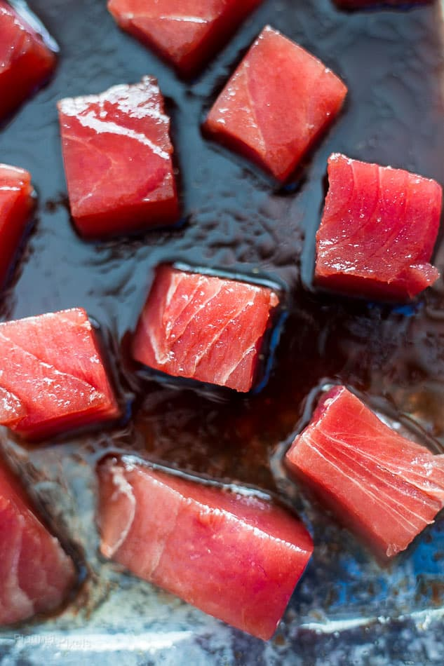 Raw Ahi Tuna squares marinating in sauce
