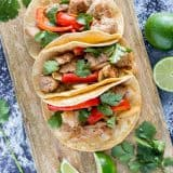 Marinated pork tenderloin, garlic, onion, bell pepper, lime and cilantro loaded into corn tortillas