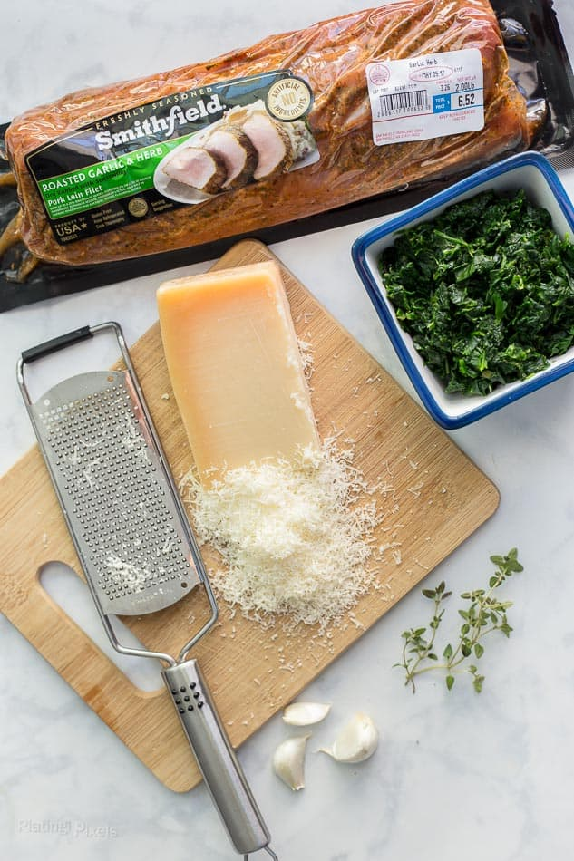 Ingredients for making Spinach Parmesan Stuffed Pork Loin on a worktop