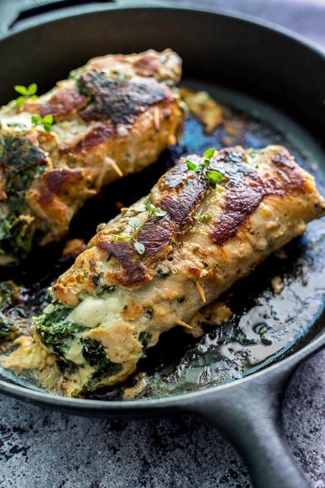 Spinach Parmesan Stuffed Pork Loin cooking in a skillet pan