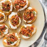Sun Dried Tomato Ricotta Crostini on a servings plate