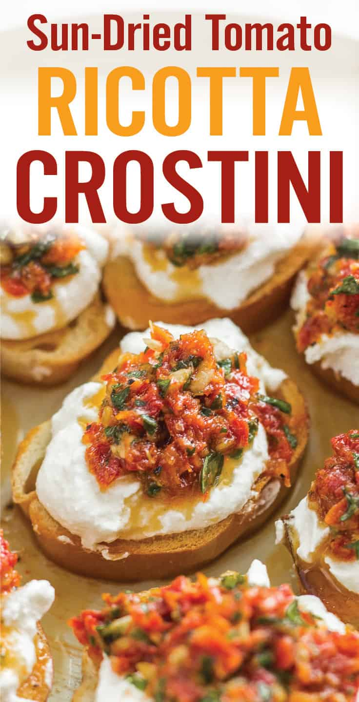 A Quick Sun-dried Tomato Ricotta Crostini party appetizer recipe. Sun-dried tomatoes, basil, garlic, pepper and ricotta served over crispy crostini pieces. These little bites are packed with flavor and make a great speedy snack, light lunch or appetizer. #sundriedtomatoes #crostini #ricottacrostini