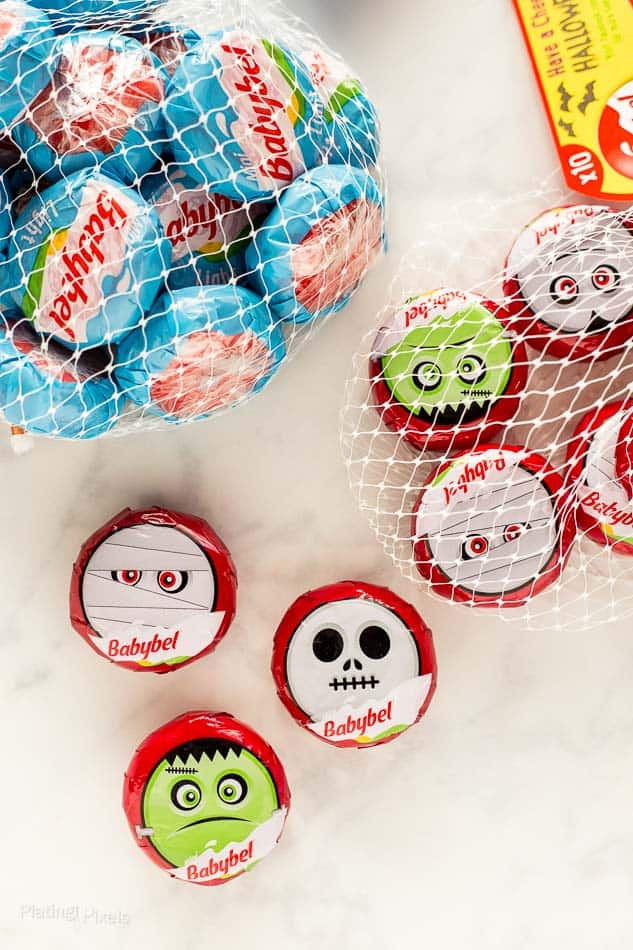 Two packages of Babybel Halloween themed mini cheese wheels