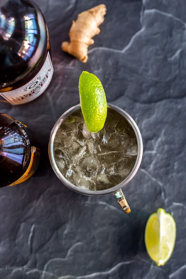 Overhead shot of Caribbean Mule in a copper mug garnished with lime wedge (Moscow Mule with rum)