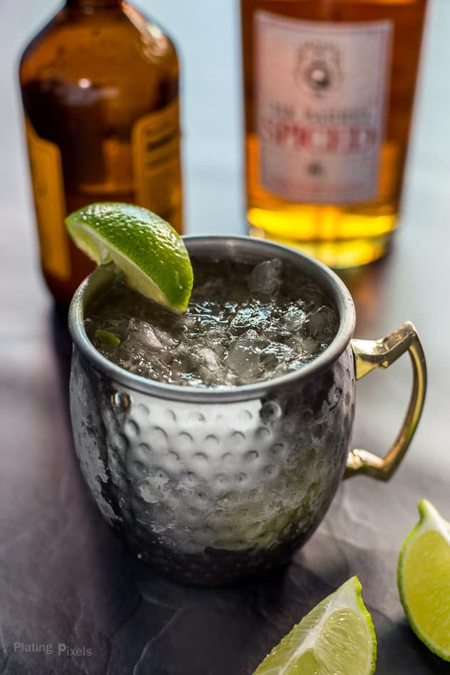 Prepared Caribbean Mule in a copper mug garnished with lime wedge (Moscow Mule with rum)