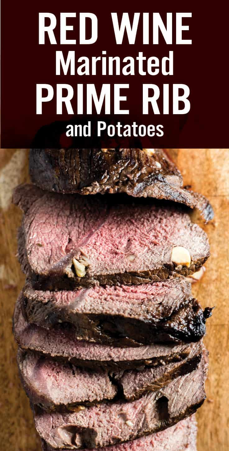 This Red Wine Marinated Prime Rib with Potatoes is a unique holiday meal. Marinated in red wine, garlic and herbs, and cooked with roasted potatoes. It\'s perfect for a festive Christmas or holiday feast. #primerib #roastbeef