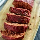 Cooked Moist Sous Vide Meatloaf slices on a wooden cutting board