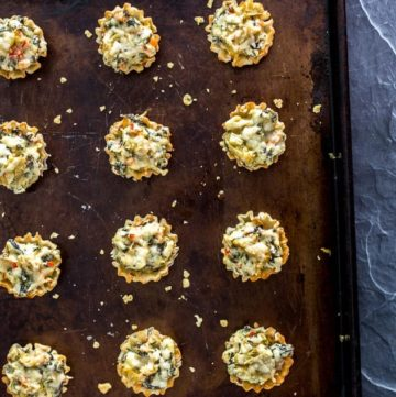 15 Mini Parmesan Spinach Phyllo Cup Appetizers on a baking sheet