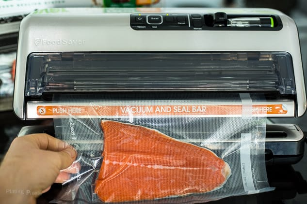 Sealing salmon filet in a vacuum food sealer