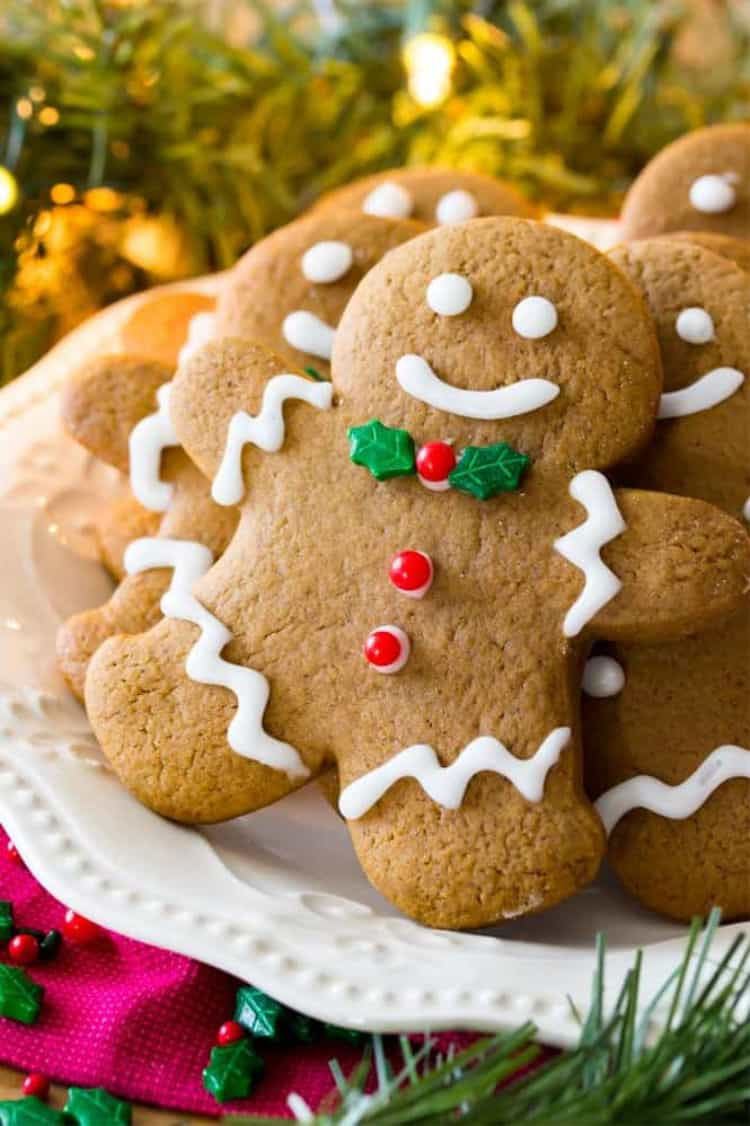 Close up of gingerbread man decorated Christmas cookies on a plate