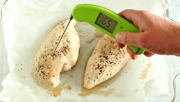 Checking baked chicken breast internal temp of 165 with a digital thermometer