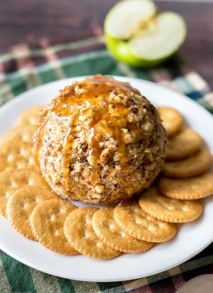 Caramel Apple Cheese Ball on plate surrounded by crackers