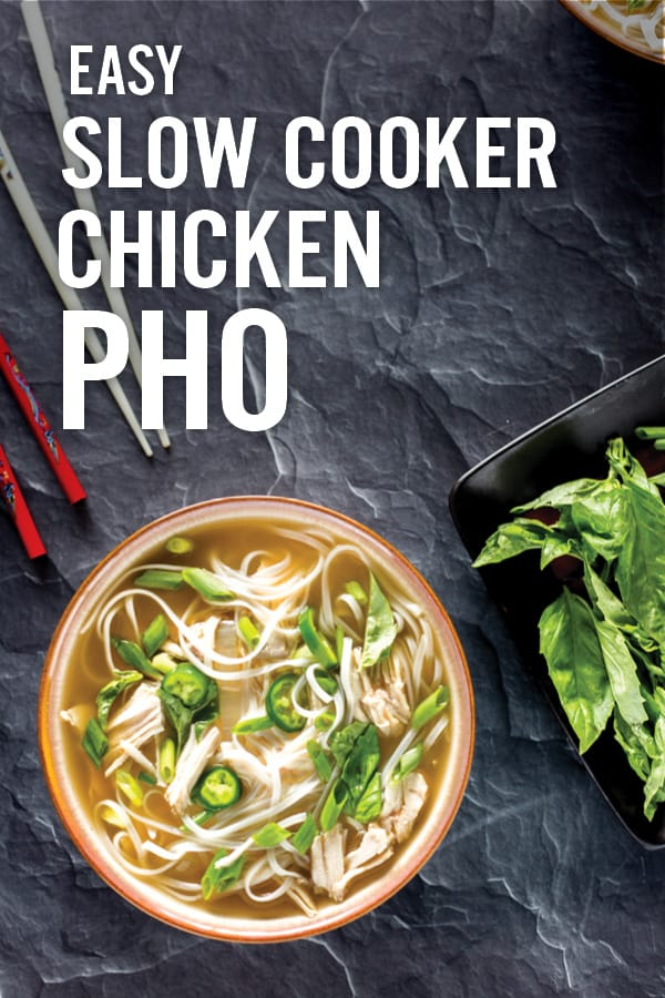 Slow Cooker Chicken Pho soup made easy with slow cooked chicken breast in bone broth. Served with rice noodles and plenty of fun, yummy add-ins for a wholesome, gluten-free pho soup. Cooked in one pot for easy cleanup.  #phosoup #slowcookerpho #chickenpho #easypho