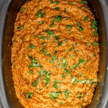 Chorizo Queso Dip in a slow cooker garnished with cilantro