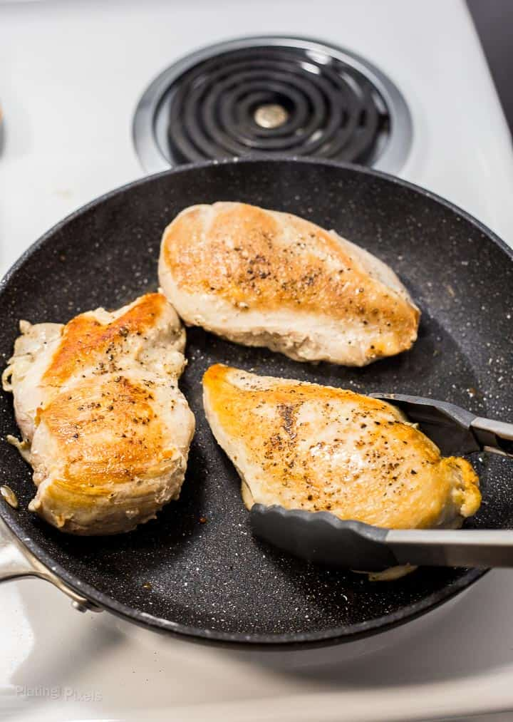 Browning turkey breasts in pan on stove