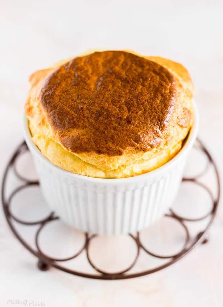 Angled shot of Easy Cheese Souffle with Brie Cheese sitting on cooling rack