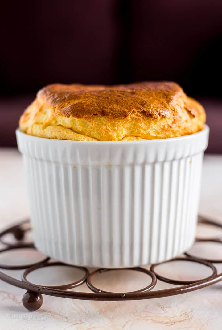 Side shot of Easy Cheese Souffle with Brie Cheese sitting on cooling rack