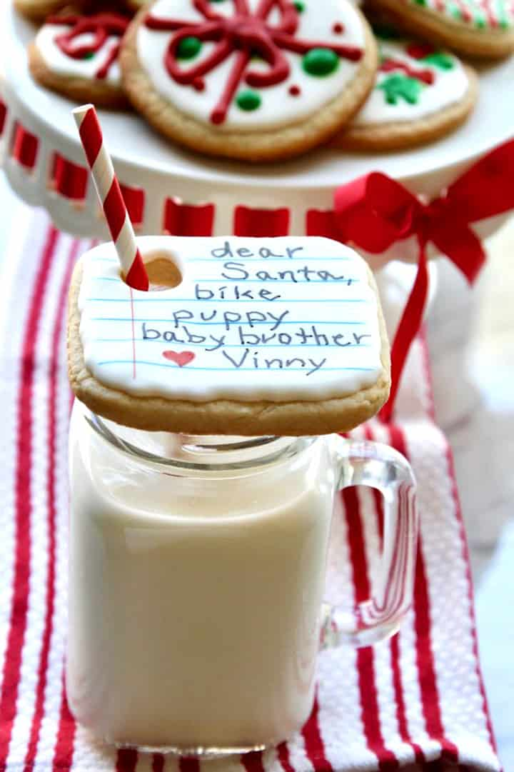 Iced decorated note to Santa Christmas cookie over a glass of milk
