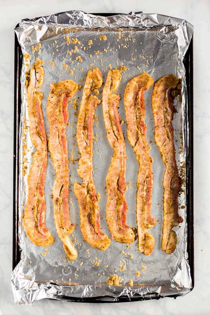 Bacon coated in brown sugar prepared on a baking sheet