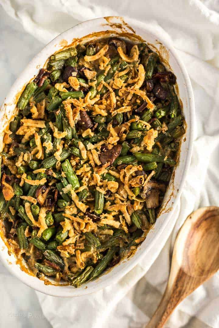 Overhead shot of cooked String Bean Casserole with Candied Bacon in a oval casserole dish