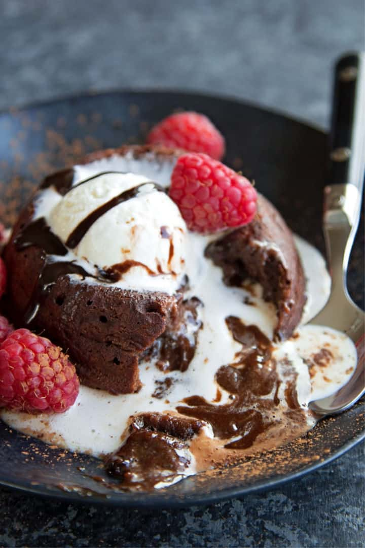 Closeup of oozing Chocolate Molten Lava Cake - Roundup of Romantic Chocolate Desserts for Valentine's Day