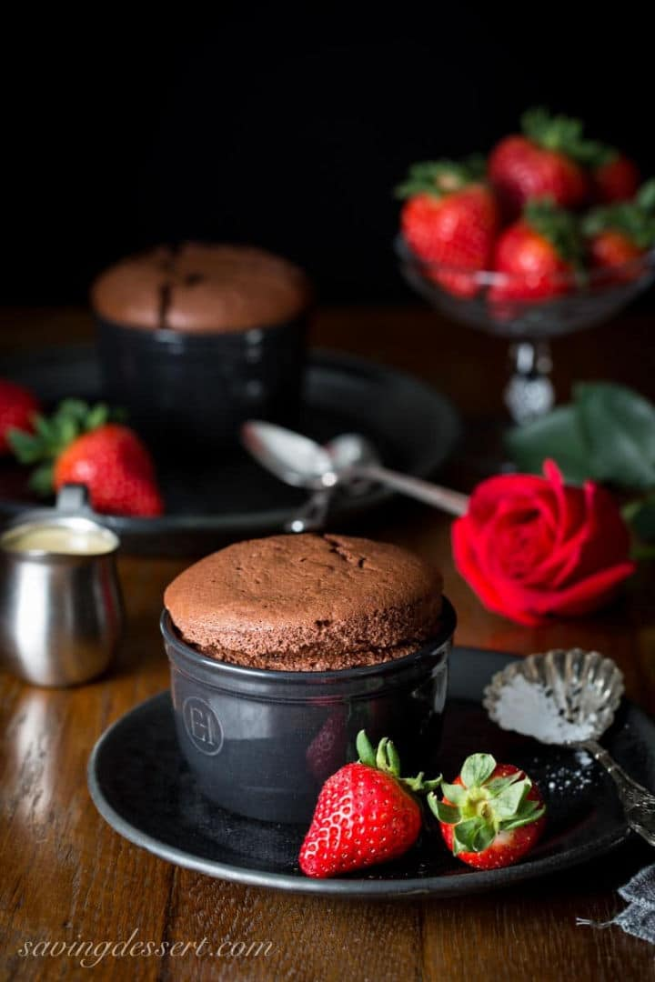 Chocolate Souffle with Baileys Creme Anglaise in a black ramekin - Roundup of Romantic Chocolate Desserts for Valentine's Day