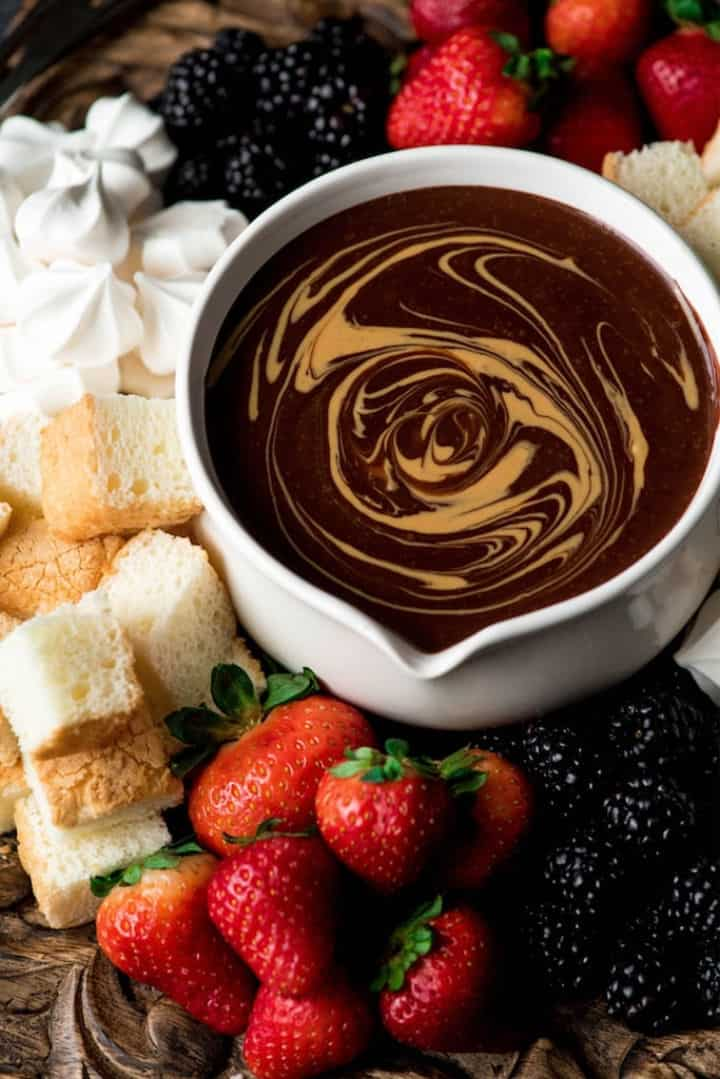 Dairy Free Chocolate Peanut Butter Fondue surrounded by mix-ins - Roundup of Romantic Chocolate Desserts for Valentine's Day
