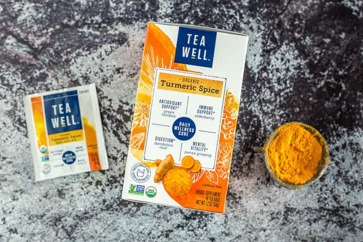 TeaWell™ Organic Turmeric Spice package next to turmeric powder