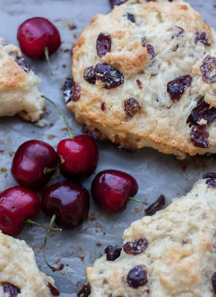 Close up of white chocolate cranberry scones on a baking sheet
