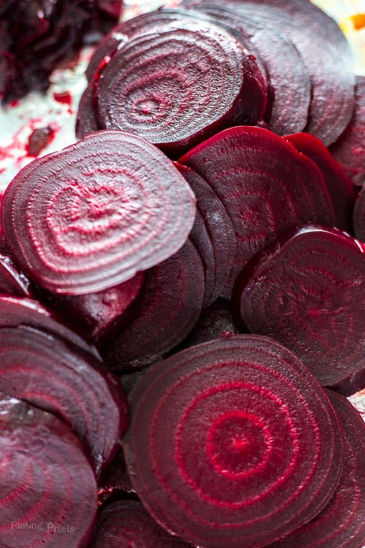 Pile of peeled roast beet slices for Refrigerator Pickled Beets