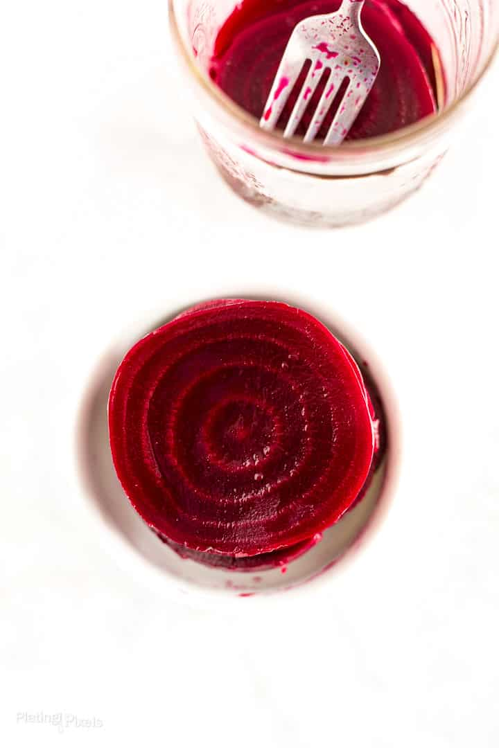 Overhead shot of a Refrigerator Pickled Beet slice in a serving dish