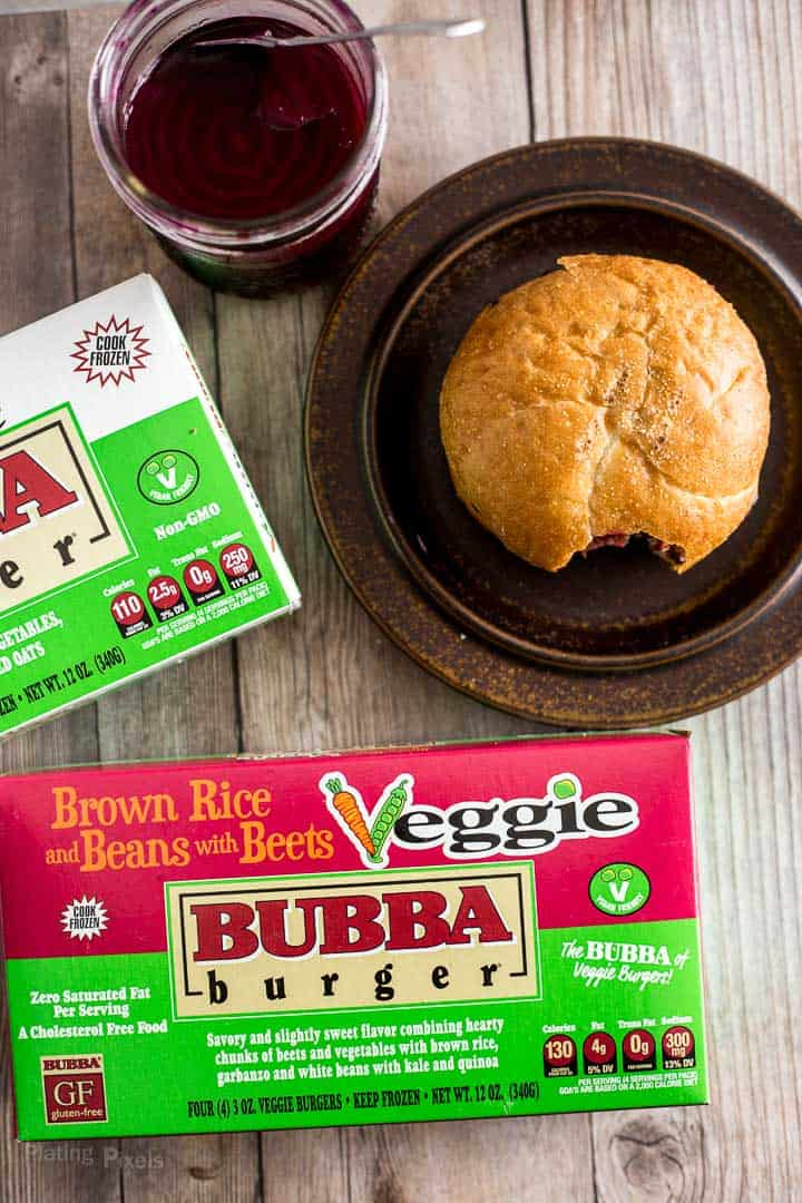 Overhead shot of a grilled veggie burger and BUBBA veggie burger product boxes