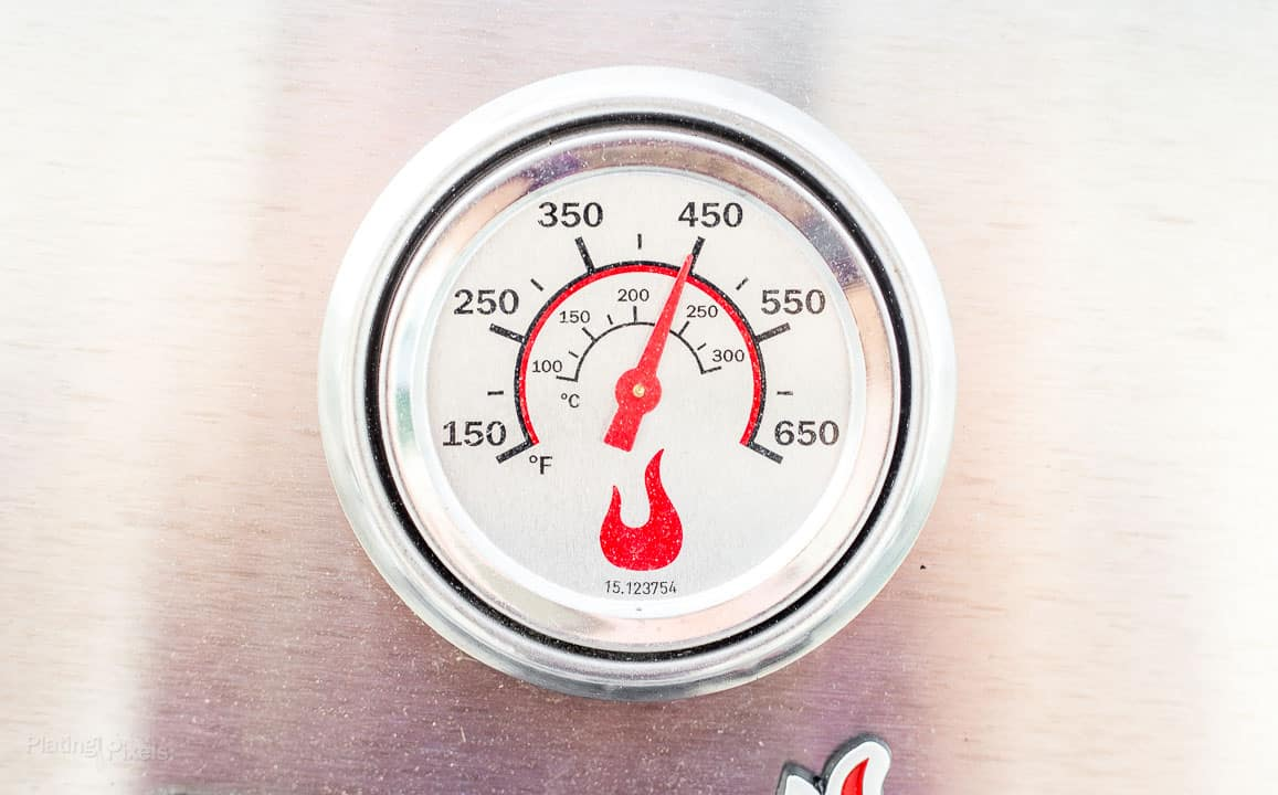 Temperature gage on a pre-heated gas grill showing 450 degrees